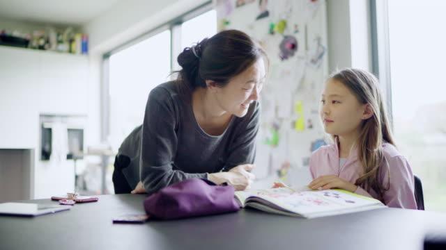 girl doing homework - homework stock videos & royalty-free footage