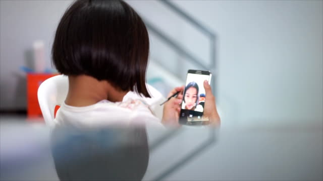 Girl doing selfie and edit photos.
