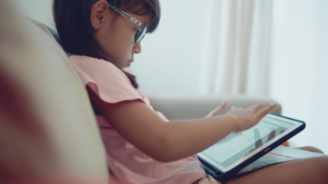 girl doodling on tablet - child sitting cross legged stock videos & royalty-free footage