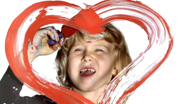 hd: girl drawing a heart on glass - painted image stock videos & royalty-free footage