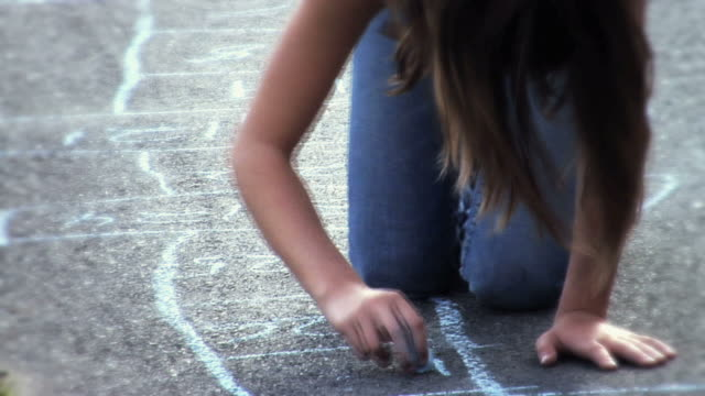 ms td girl drawing hopscotch with colored chalk on sidewalk  / langley, british columbia, canada.           - gessetto da lavagna video stock e b–roll