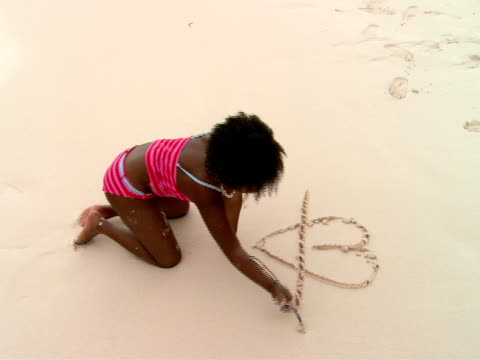 ms,  ha,  girl (8-9 years) drawing in sand,  harbour island,  bahamas - 8 9 years stock videos & royalty-free footage