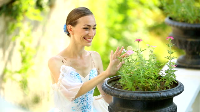 girl dressed as a ballerina in the park with flowers - fine art portrait stock videos & royalty-free footage
