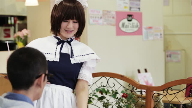 ws, tu a girl dressed as a maid takes drinks to a customer in a tokyo maid cafã© / tokyo, japan - dressing up stock videos & royalty-free footage