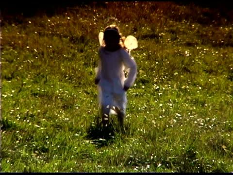 girl dressed as an angel - angel点の映像素材/bロール