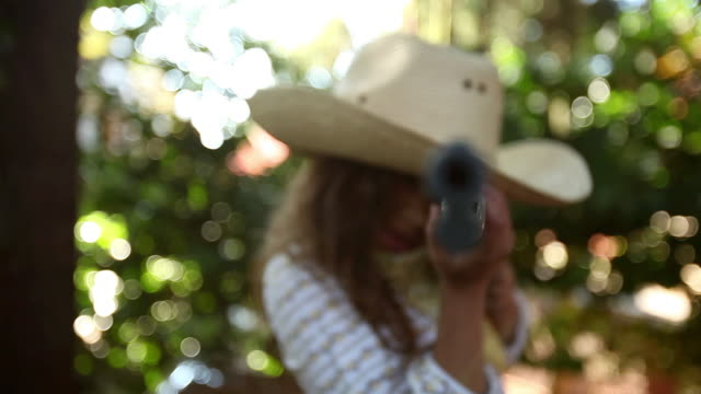 girl dressed as cowgirl pointing toy rifle at camera - toy gun stock videos & royalty-free footage