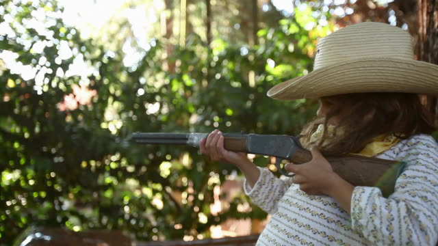 girl dressed as cowgirl with toy rifle - toy gun stock videos & royalty-free footage