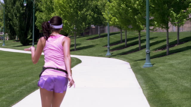 girl dressed in 80's athletic clothing roller skate dancing in the park. - knee highs stock videos and b-roll footage