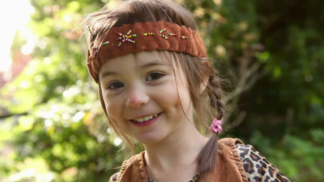 Girl dressed up as Native America with headdress
