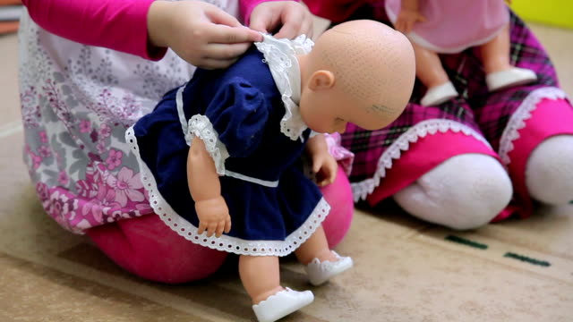 girl dressing up doll - doll stock videos and b-roll footage