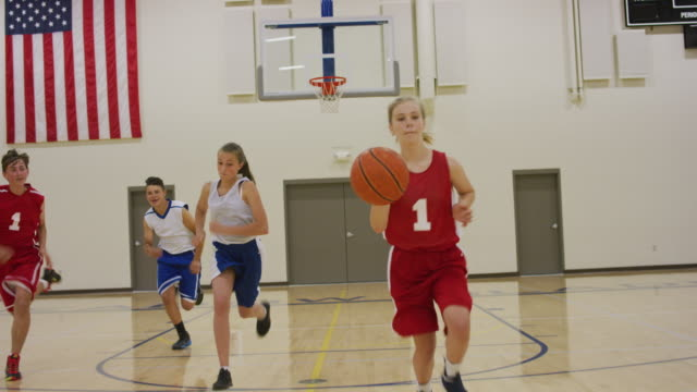 girl dribbling basketball up court - junior high stock videos & royalty-free footage
