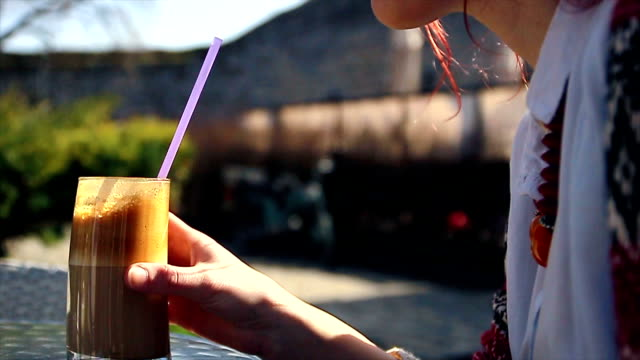 girl drink iced coffee in cafe - straw stock videos & royalty-free footage