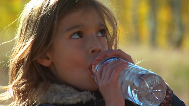 girl drinking a bottled water - see other clips from this shoot 1165 stock videos and b-roll footage