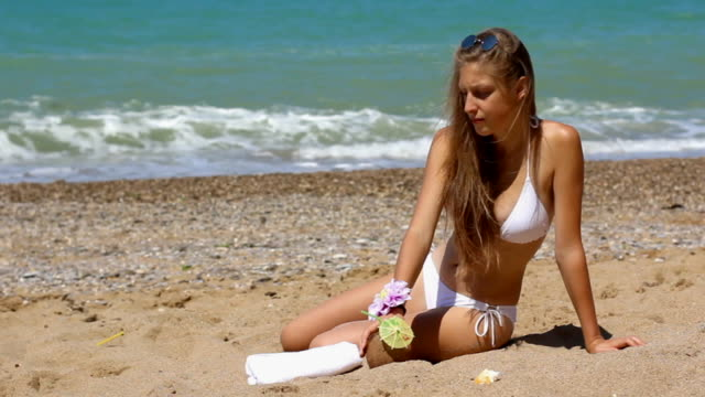girl drinking an exotic cocktail