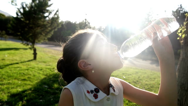 girl drinking water outdoors - bottle stock videos & royalty-free footage