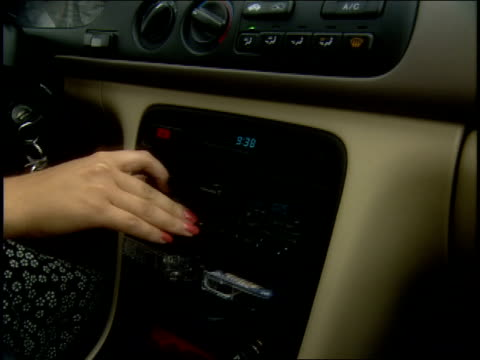girl driving and adjusting cassette in radio in pennsylvania - audio equipment stock videos & royalty-free footage