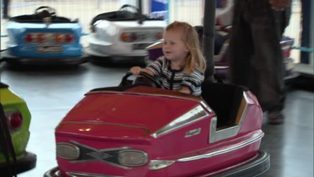 MS, ZI, PAN, Girl (2-3) driving bumper car, Dallas, Texas, USA
