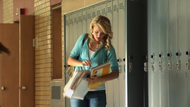 girl dropping books in hallway - see other clips from this shoot 1148 stock videos & royalty-free footage