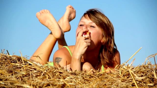 girl eating a peach