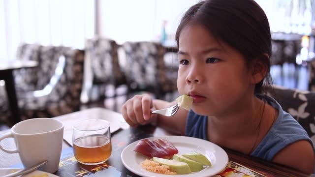 HD : Girl eating breakfast