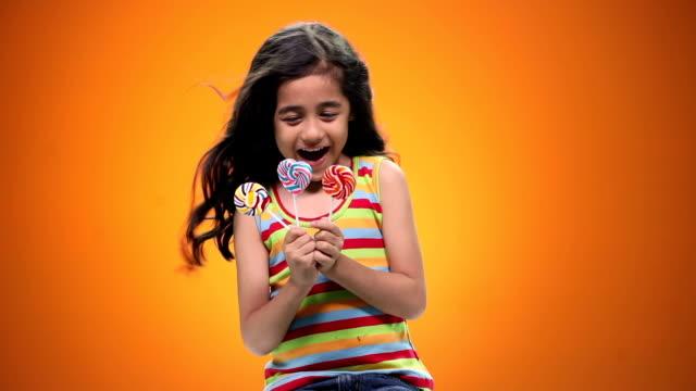 Girl eating candies