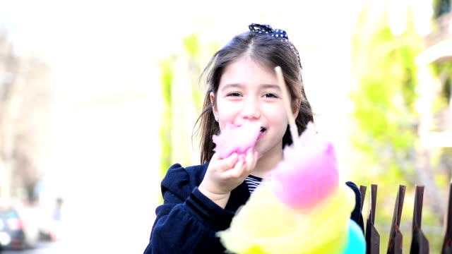 Girl eating cotton candy