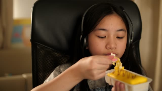 girl eating food and listening the music - yellow stock videos & royalty-free footage