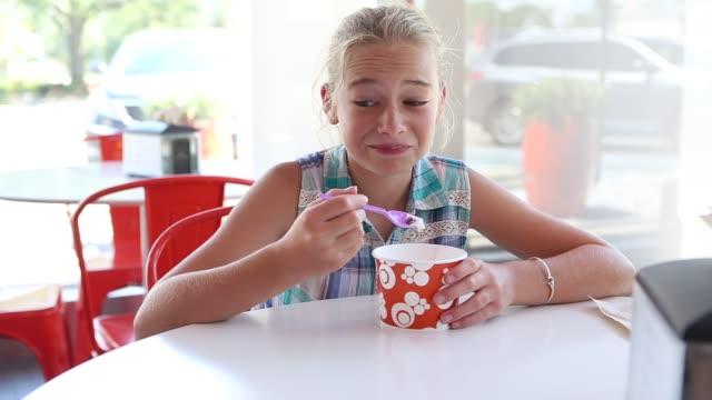 girl eating frozen yogurt - frozen yogurt stock videos and b-roll footage