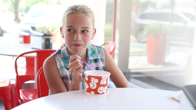 girl eating frozen yogurt - yoghurt stock videos and b-roll footage