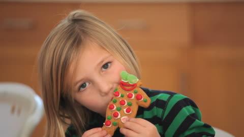 cu girl (4-5) eating gingerbread man cookie / richmond, virginia, usa - indulgence stock videos & royalty-free footage
