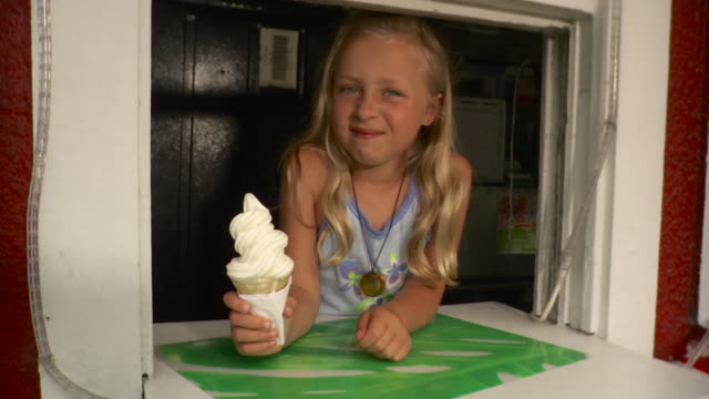 ms girl (8-9) eating ice cream cone at snack bar window / stowe, vermont, usa - ice cream cone stock videos & royalty-free footage