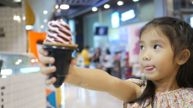 girl eating ice cream cone - weekend activities stock videos and b-roll footage