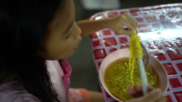 girl eating noodle at night - 1976 stock videos & royalty-free footage
