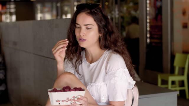 girl eating raspberries/ krakow/ poland - raspberry stock videos & royalty-free footage