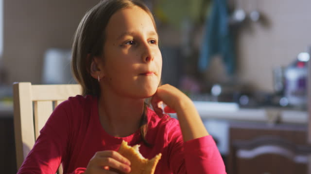 girl eating toaster at the table - toaster appliance stock videos & royalty-free footage
