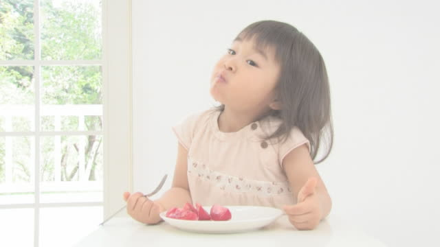 girl eating tomato giving a thumb up - preschool student stock videos and b-roll footage
