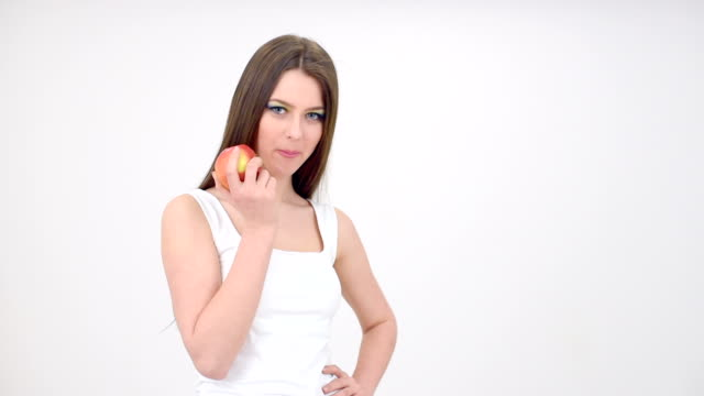 girl eats apple - young animal stock videos & royalty-free footage