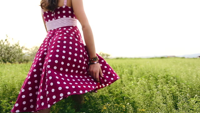 Girl enjoy in spring green field