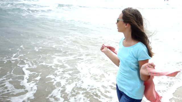 girl enjoying a walk by the sea - pre adolescent child stock videos and b-roll footage