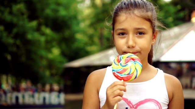 girl enjoying big lollipop - lollipop stock videos and b-roll footage