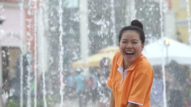 Girl Enjoying Fountain (Super Slow Motion)