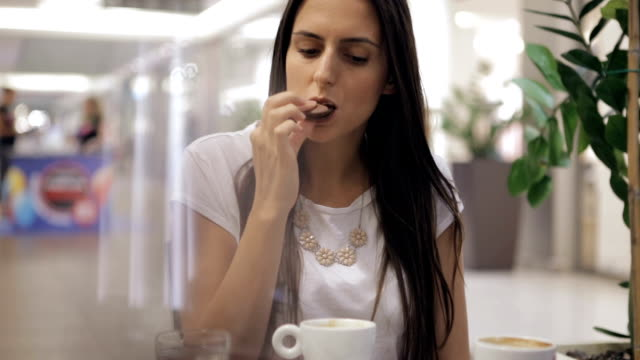 girl enjoying in a coffee shop - macaroon stock videos and b-roll footage