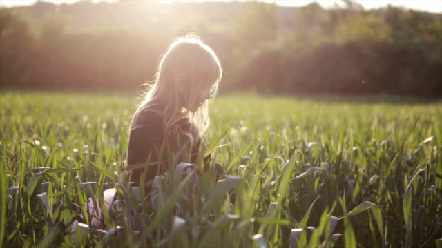 Girl enjoying the wheat field