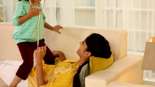 girl examining her mother at home, delhi, india - imagination stock videos & royalty-free footage
