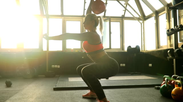 girl exercises with dumbbell - crouching stock videos & royalty-free footage