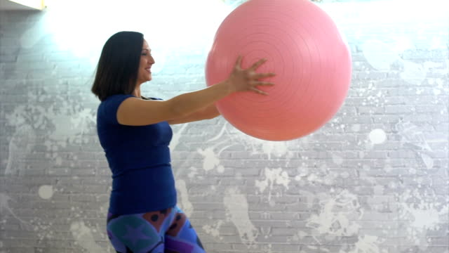 girl exercises with fitness ball - fitness ball stock videos & royalty-free footage