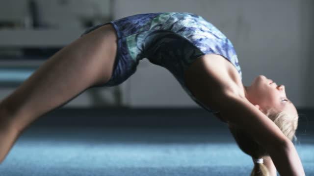MS Girl (10-11) exercising in gym, Orem, Utah, USA