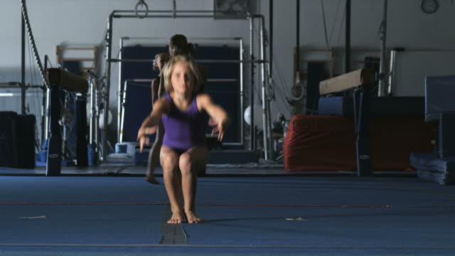 WS Girl (8-9) exercising in gym, Orem, Utah, USA