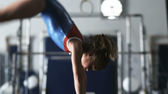 ms girl (8-9) exercising on balance bar in gym, orem, utah, usa - three quarter length stock videos & royalty-free footage