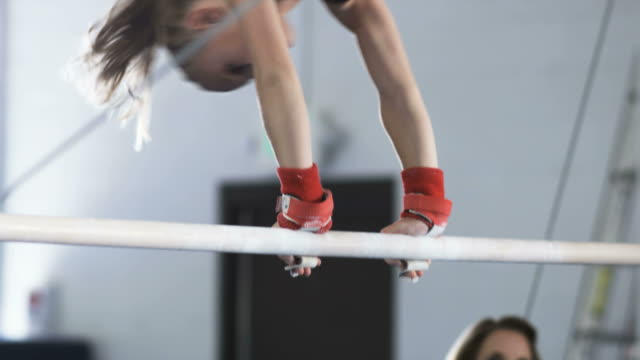 ms girl (10-11) exercising on uneven bar, orem, utah, usa - gymnastics stock videos & royalty-free footage